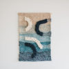 Cassandra Sabo's 'Salmon' handwoven textile wall-hanging from her West Coast Collection