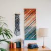 Cassandra Sabo's 'Shoreline' handwoven textile wall-hanging from her West Coast Collection hung on the wall beside another Macraweave wall-hanging.