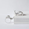 Silver Wave Collection - silver ring and matching brooch on white background