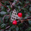 Silver Beaded Quatrefoil Ring - view from the side - against foliage background