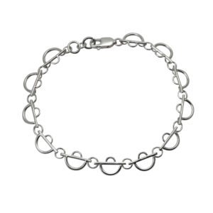 Faceted arc lace cuff bracelet on white background Sterling Eco-Silver