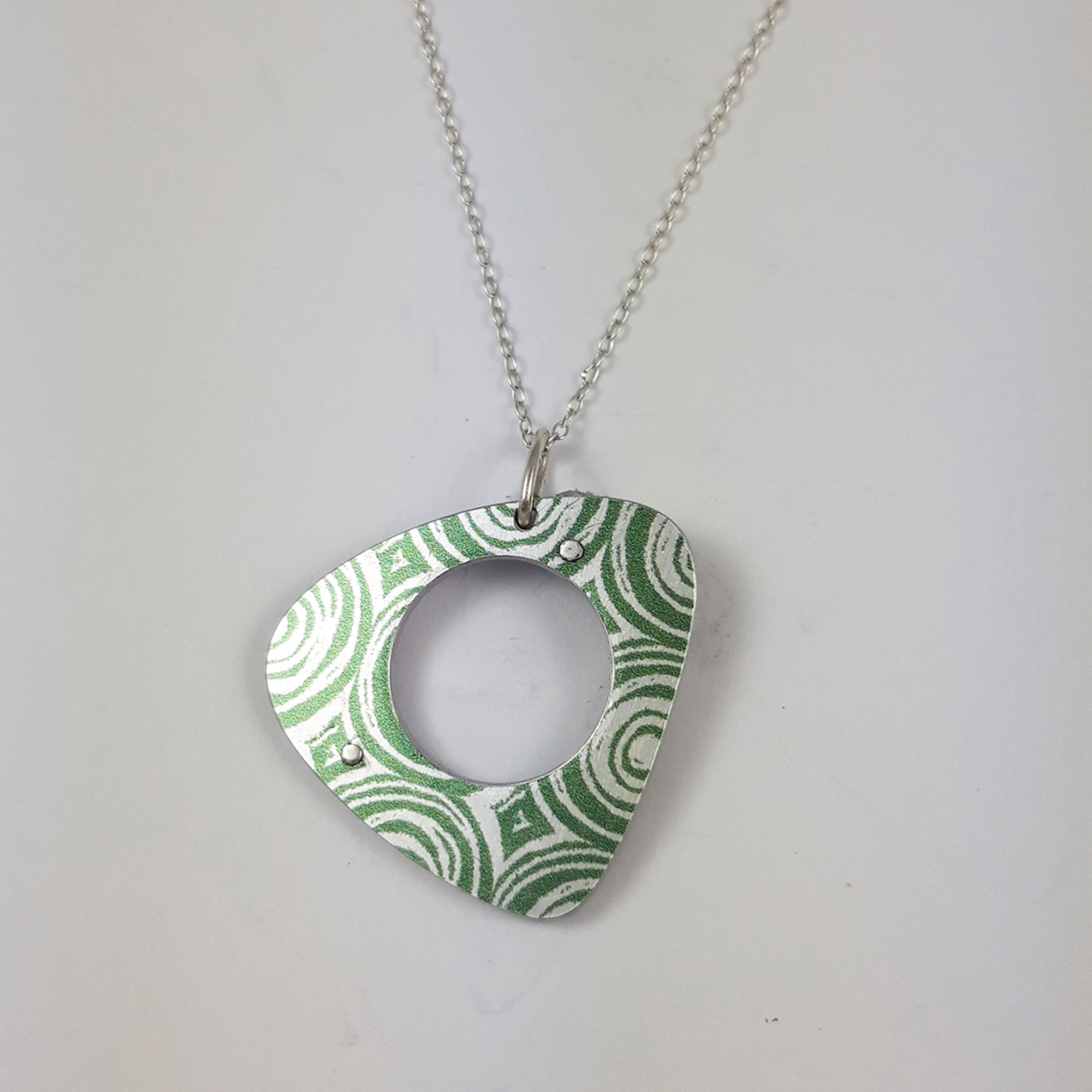Green side of reversible suffragette pendant necklace