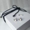 Handcrafted Silver Earrings on the white gift box tied with black cotton string.