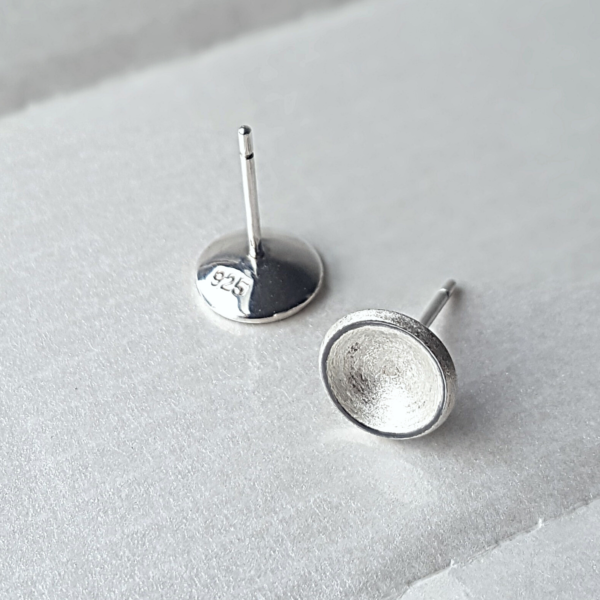 Circle Silver Stud Earrings on a white surface.