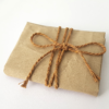 Brown wrapping paper tied with brown cotton string.